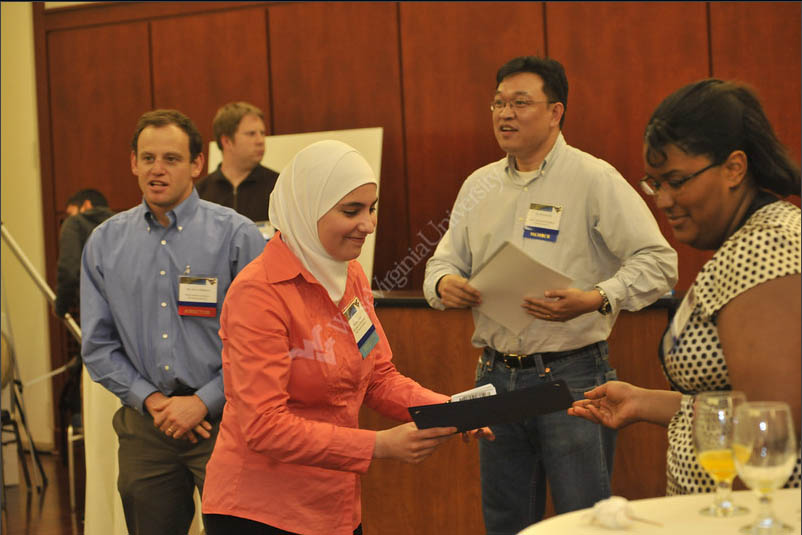 Therwa Hamza (PhD student) receiving the Best Graduate Student Poster Prize at the WVNano Research Symposium