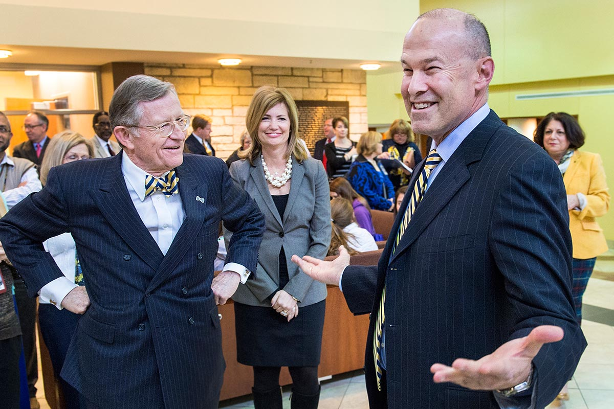 Clay Marsh sharing a moment with President Gorden Gee in the Pylon Common Area at the Health Sciences Center.