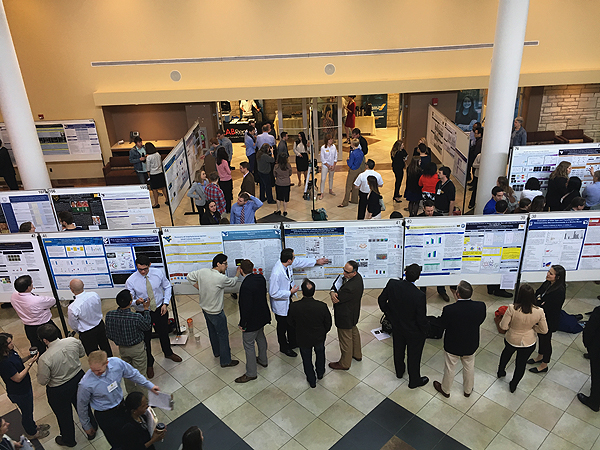 Students and Faculty observing posters at the 2017 E.J. Van Liere Memorial Convocation and HSC Research Day