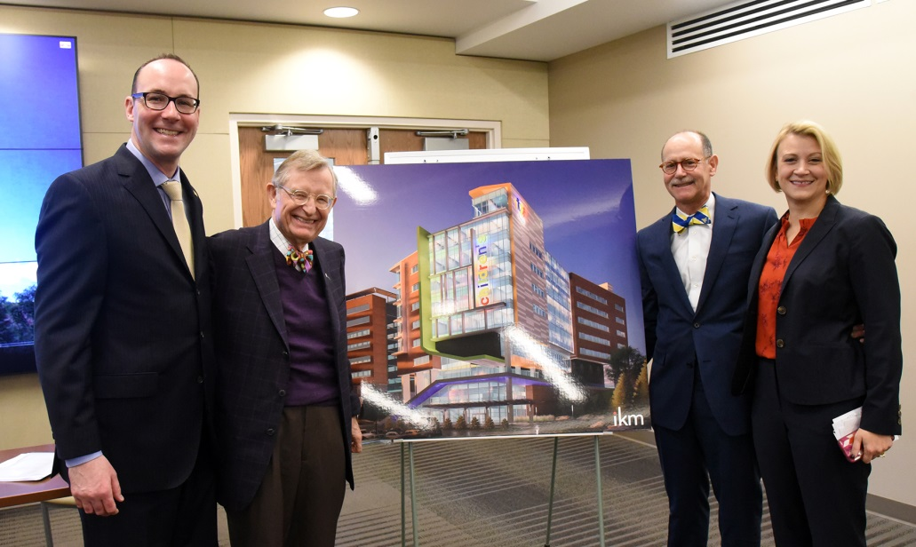 Albert L. Wright, Jr., Gordon Gee, J. Philip Saul, M.D., and and Natalie Jefferis standing beside a rendering of the new childrens hospital building.