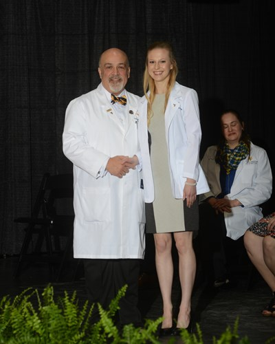 Photo of Kathryn Baker receiving her white coat.